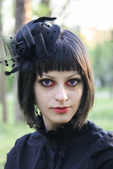 Beauty goth girl walks in park