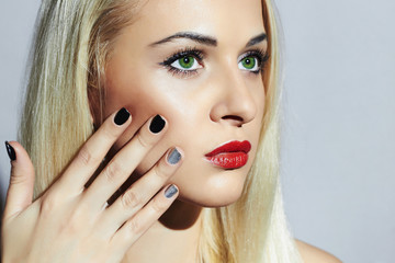 Beautiful blond Woman with Manicure.Beauty Girl.shellac design