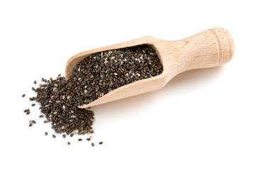chia seeds in a wooden scoop isolated on white