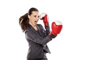 Profile of angry business woman, attack with boxing gloves