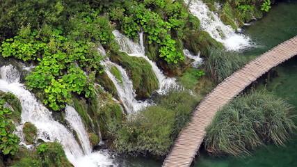 Wooden Path Along Water Cascade