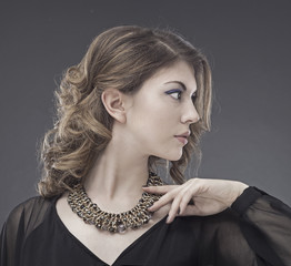 Beautiful young woman. Jewelry. Fashion photo