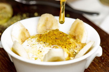 Middle eastern creamy dessert with nuts and honey
