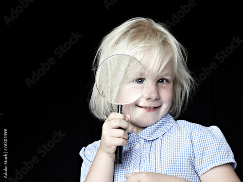canvas print picture Blond girl laughing with magnifier