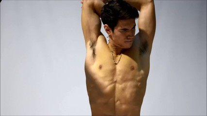 Attractive shirtless young man stretching muscles