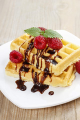 Waffles with chocolate and raspberries