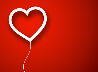 Paper balloon heart over red.