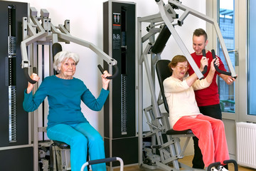 Old Women Exercising at Gym with Instructor.