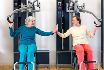 Old Ladies Exercising While Touching their Palms.