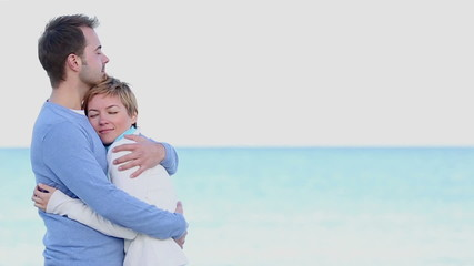 beautiful young couple embracing on the beach