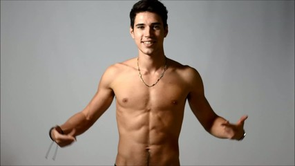 Attractive shirtless young man pointing at empty space