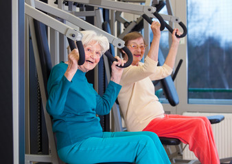 Healthy Old Women Exercising at the Gym.