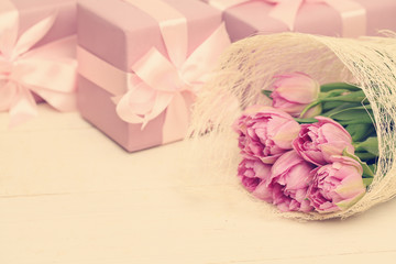 Holiday background with flowers, gift box and silky ribbon