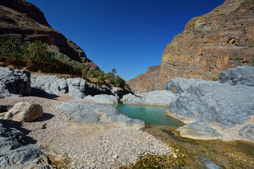 Natural pool between the mountains of Oman