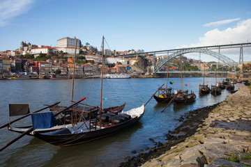 Boats on Douro River and Porto Skyline in Portugal