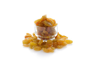 yellow sweet raisins on white background