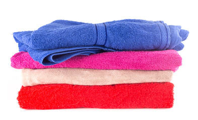 Heap of colorful towel on white background