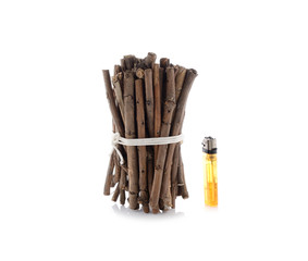 bundle of firewood with lighters on white