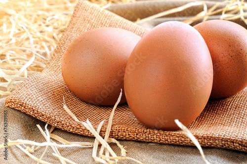 eggs on a burlap bag on a table - 76309863