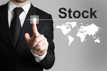 businessman pushing button stock market international