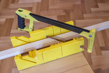 Using hand saw and miter box 2