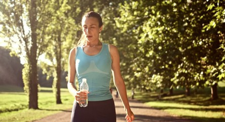 Active Attractive Young Sport Woman Jogging Drinking Water