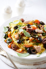 Tagliatelle with tuna, anchovy, olives and vegetables