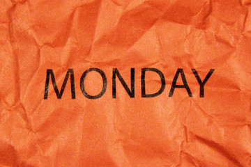 word monday on orange paper