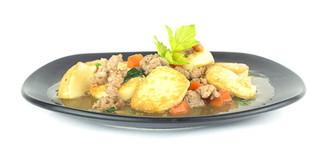 Stir fried tofu with pork and carrot on white
