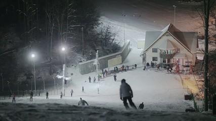 People skiing at night