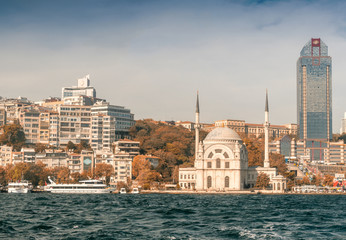 Dolmabahce Mosque on the banks of the Bosphorus, with Istanbul c
