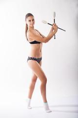 Gymnast with clubs. studio portrait