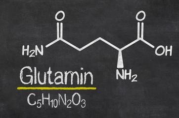 Schiefertafel mit der chemischen Formel von Glutamin
