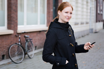 Woman with a Mobile Phone in a City