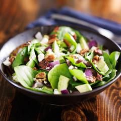 avocado spinach salad close up in bowl