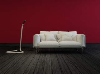 White sofa in a sombre room with red walls