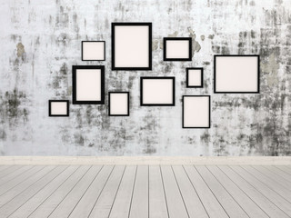 Group of empty picture frames hanging on a wall