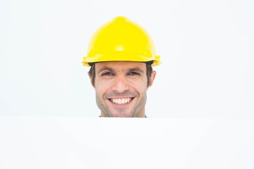 Happy architect with bill board over white background
