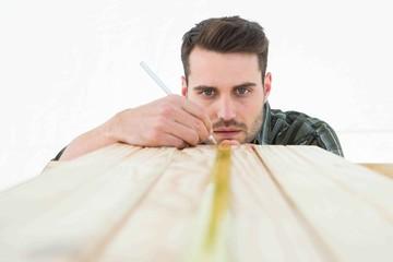 Carpenter marking on wooden plank