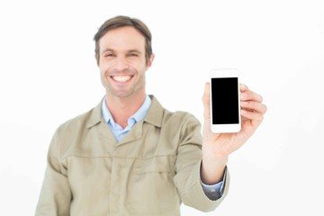 Smiling delivery man showing smart phone