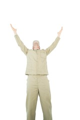 Excited delivery man with arms raised looking up