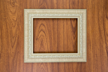 Ivory frame on brown wood background
