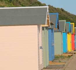 Some Traditional Brightly Coloured Wooden Beach Huts.
