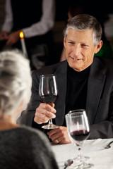 Restaurant: Couple Drinking Wine At Dinner