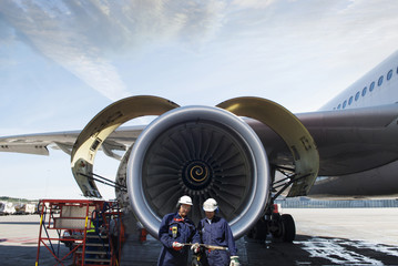 airplane, jet and two aircraft mechanics
