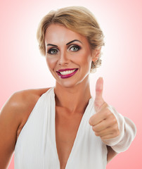 Smiling woman showing tumb sign