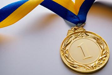 Gold medal on a light background