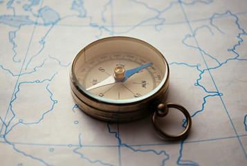 Magnetic compass lying on a map