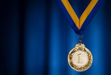 Gold medal on a dark blue background