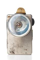 Old grunge flashlight on white background